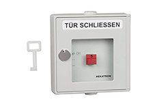 Joachim_Michel_Brandmeldetechnik-Handausloesung-grau-DKT-01TTitel